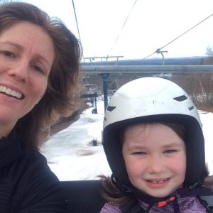 Alyssa Bresnahan on a chairlift with her daughter